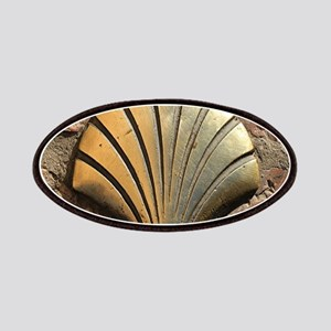 Gold El Camino shell sign, pavement, Leon, S Patch