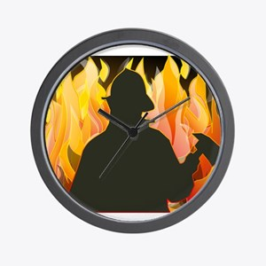 Firefighter silhouette against flames Wall Clock