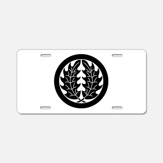 Embracing holly leaves in c Aluminum License Plate