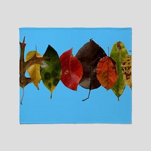 Autumn leaves on sky blue Throw Blanket