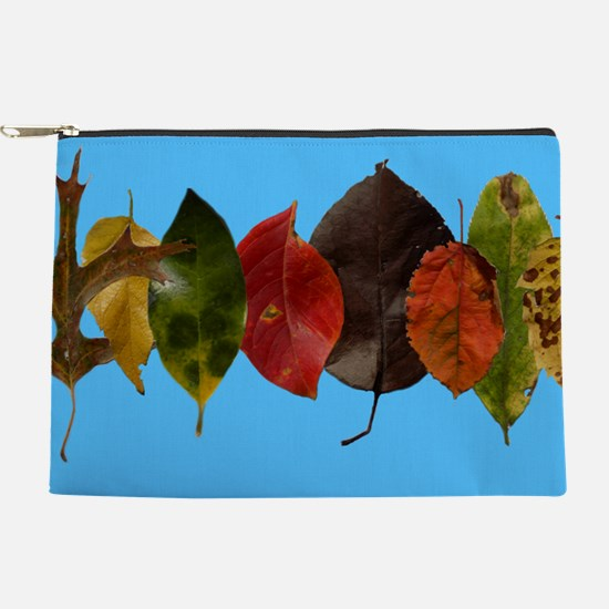 Autumn leaves on sky blue Makeup Pouch