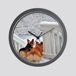 Two Corgis in winter snow Wall Clock