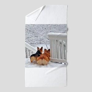 Two Corgis in winter snow Beach Towel