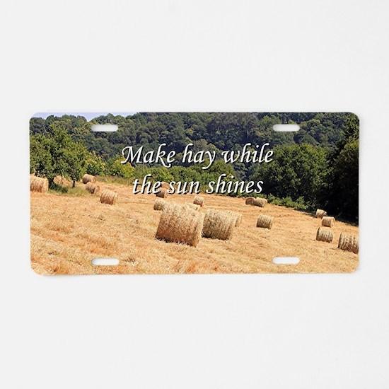 Make hay while the sun shin Aluminum License Plate