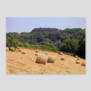 Round hay bales in field on El Cami 5'x7'Area Rug