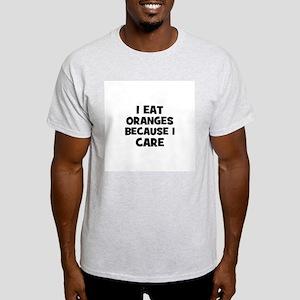 I eat oranges because I care Light T-Shirt