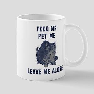 Feed me pet me leave me alone Mug