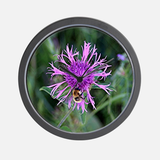 Purple pink flower and bee Wall Clock