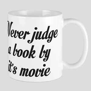 NEVER JUDGE A BOOK BY IT'S MOVIE Mugs