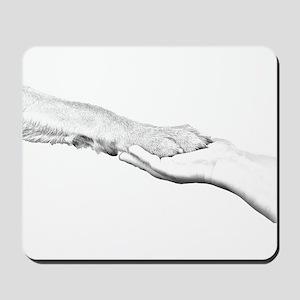 dog paw and human hand Mousepad