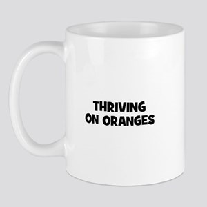 Thriving on oranges Mug
