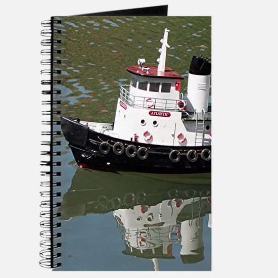 Model tugboat reflections in water Journal