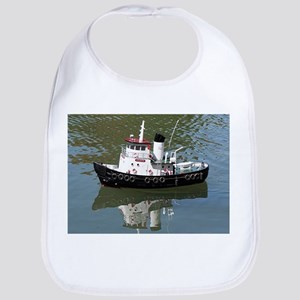 Model tugboat reflections in water Bib