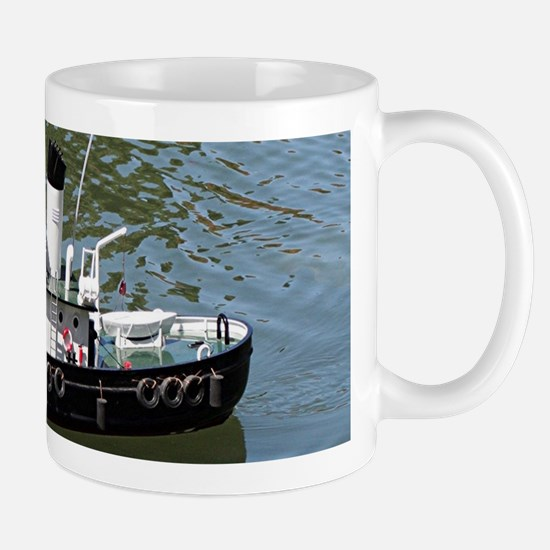 Model tugboat reflections in water Mugs