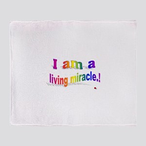 A Living Miracle Throw Blanket