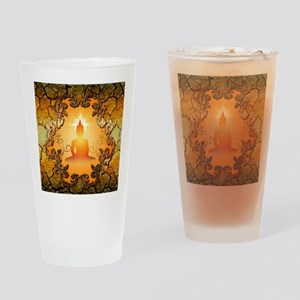 Buddha in the sunset Drinking Glass