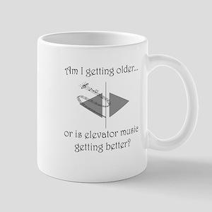 AM I GETTING OLDER OR IS ELEVATOR MUSIC Mug