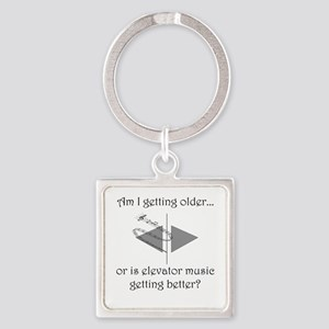 AM I GETTING OLDER OR IS ELEVATOR  Square Keychain
