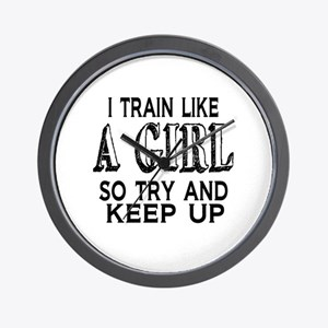 Train like a girl Wall Clock