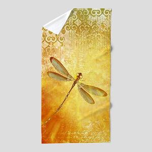 Golden dragonfly Beach Towel