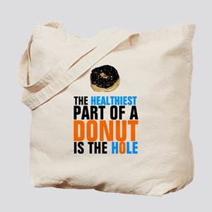 The healthiest part of a donut is the hol Tote Bag