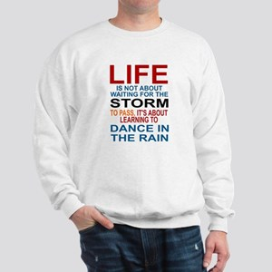 LIFE IS NOT ABOUT WAITING FOR THE STORM Sweatshirt