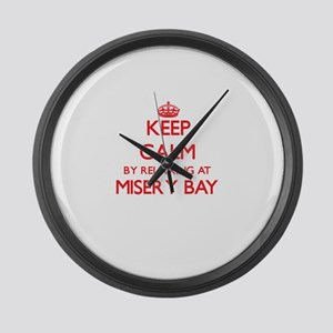 Keep calm by relaxing at Misery B Large Wall Clock