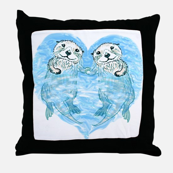 sea otters holding hands Throw Pillow