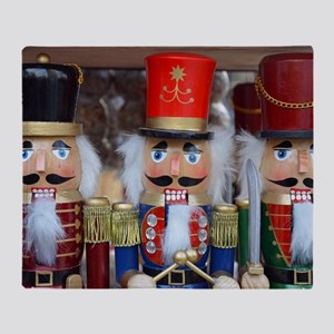 Three christmas nutcrackers Throw Blanket