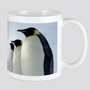 Lined up Emperor Penguins Mugs