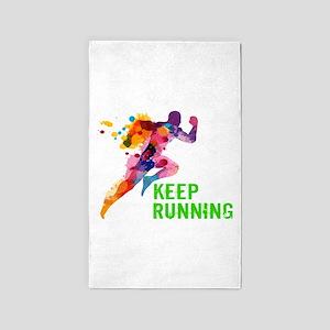 Keep Running Area Rug