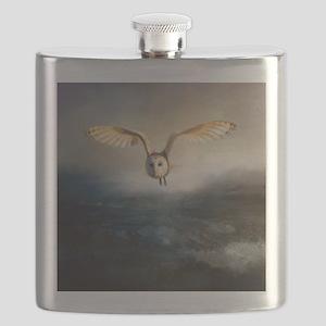 An barn owl flies over the lake Flask