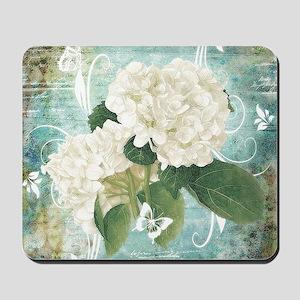 White hydrangea on blue Mousepad