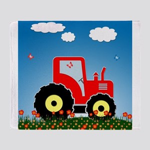 Red tractor in a field Throw Blanket