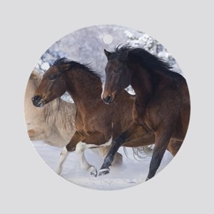 Horses Running In The Snow Round Ornament