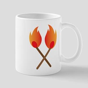 Two burning matches Mugs
