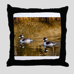 Bufflehead swimming in the winter Throw Pillow