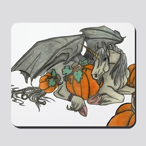 Bat winged Unicorn protecting a pumpkin Mousepad