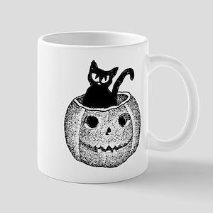 Adorable cat in pumpkin for Halloween Mugs