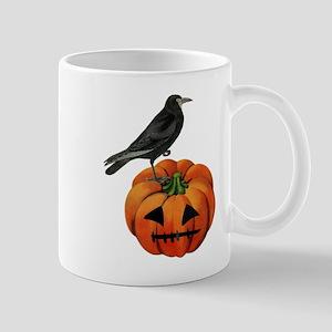 vintage halloween crow pumpkin Mugs