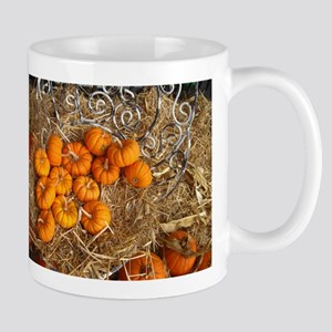 mini pumpkins on a metal chair Mugs