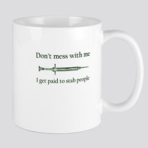 Don't mess with me I get paid to stab people Mugs