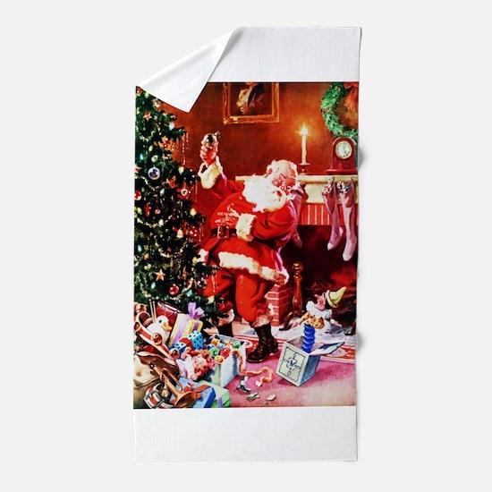 Santa Claus Decorates the Chirstmas Tr Beach Towel