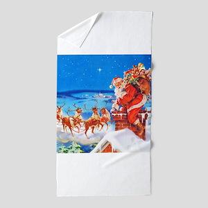 Santa and His Reindeer Up On a Snowy R Beach Towel