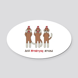 Monkeying Around Oval Car Magnet