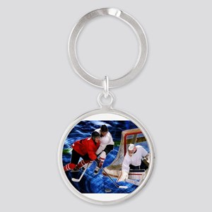 Action at the Hockey Net Keychains