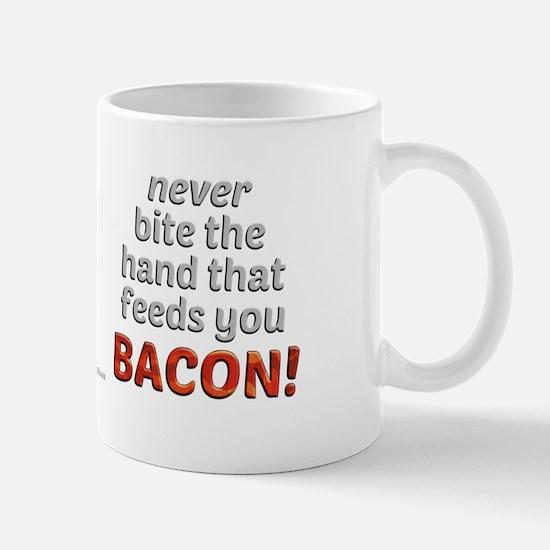 Bite the hand... Mug