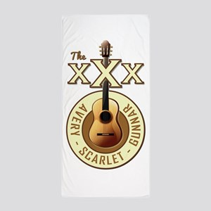 THE TRIPLE X'S Beach Towel