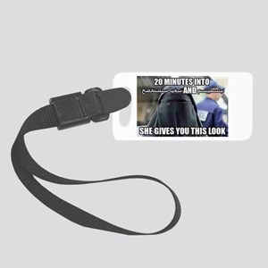 20 Minutes into.... She gives yo Small Luggage Tag