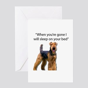 Airedale determined to sleep on you Greeting Cards